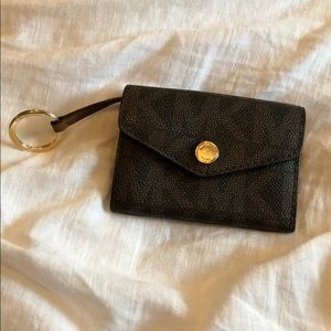 Small MK wallet, so nice for traveling!